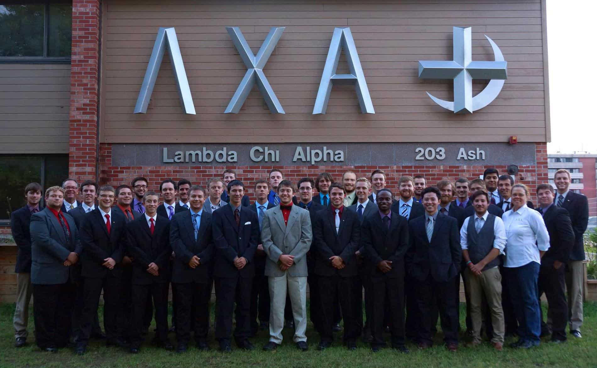 Members In Front Of Lambda Chi House